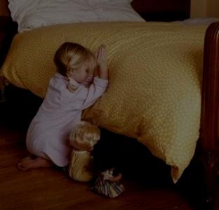 little girl saying prayers