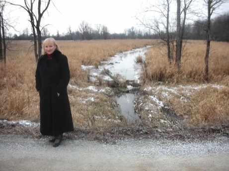 Arlene Stafford-Wilson at the creek behind Stafford House