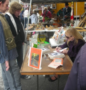 Signing a book Maple Fest Apr 27 20130001
