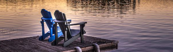 muskoka chairs at the lake