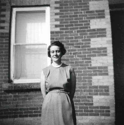 Audry in front of the house