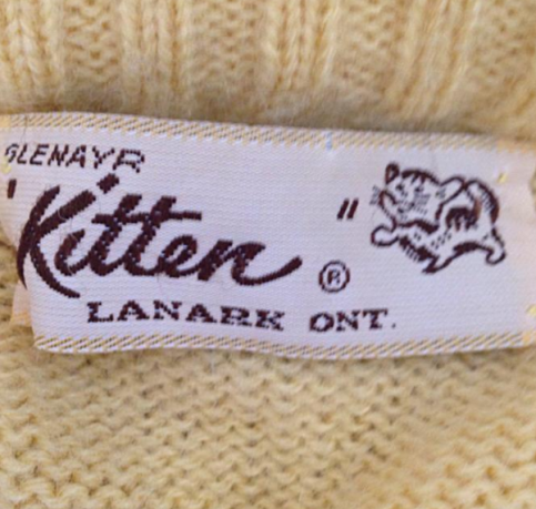kitten yellow sweater tag